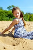 Portrait of pretty girl sitting on sand Royalty Free Stock Photography