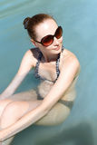 Portrait of a pretty girl sitting in the water Royalty Free Stock Images