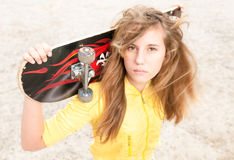 Portrait of pretty girl with skateboard outdoor. Royalty Free Stock Photo