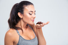 Portrait of a pretty girl smelling chocolate Stock Image