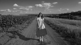 Portrait of a pretty girl standing on a dirt road Royalty Free Stock Photo