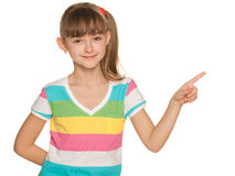 Young girl in striped blouse makes a hand gesture Stock Image