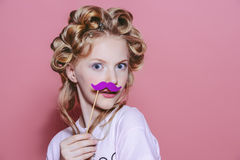Teen with curlers Stock Photography