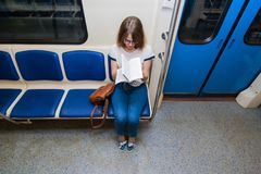 Portrait of young woman tourist in metro waggon stock photography