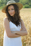 Portrait of pretty girl in wheat field Royalty Free Stock Photos