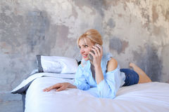 Portrait of pretty girl, who chatting on cell phone and smiling, Stock Images