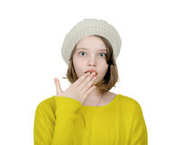 Portrait of a pretty girl who covers her mouth with her palm on. Portrait of a pretty girl on a white background Stock Image