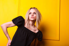 Portrait of pretty girl on yellow background Royalty Free Stock Photography
