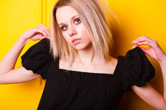 Portrait of pretty girl on yellow background Royalty Free Stock Image