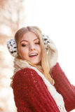Portrait of pretty gorgeous woman in earmuffs. Stock Images