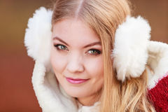 Portrait of pretty gorgeous woman in earmuffs. Royalty Free Stock Photography