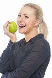 Portrait of Pretty and Happy Blond Female Biting Green Juicy App Royalty Free Stock Photos