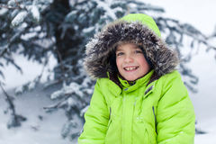 Portrait of pretty happy boy in winter snow park Royalty Free Stock Image