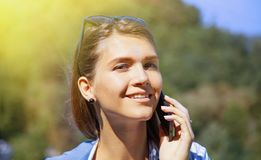 Portrait of pretty happy lovely young woman speaking on mobile p royalty free stock photography