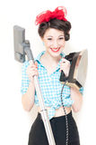 Beautiful young house wife with iron & vacuum cleaner on white Royalty Free Stock Photo