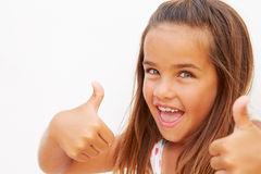 Portrait Of Pretty Hispanic Girl Making Thumbs Up Gesture Stock Photo