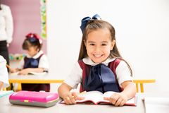 Beautiful girl enjoying school with a smile royalty free stock photo