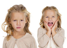 Portrait of a pretty liitle girls. Portrait of beautiful two little girls, studio on white background Royalty Free Stock Photo