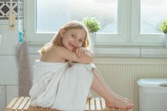 Portrait of pretty little child girl with white towel after show Royalty Free Stock Image