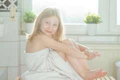 Portrait of pretty little child girl with white towel after show Stock Photo