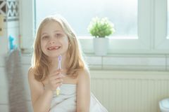 Portrait of pretty little child girl with white towel after show Stock Images