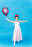 Portrait of pretty little girl with balloon on blue background Royalty Free Stock Image