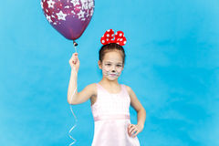 Portrait of pretty little girl with balloon on blue background Royalty Free Stock Images