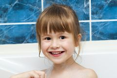 Portrait of pretty little girl in bath. Hygiene concept. Royalty Free Stock Photo