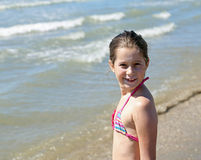Portrait of pretty little girl with a bathing suit. On the beach in summer Stock Image