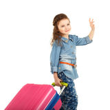 Portrait of a pretty little girl with big pink suitcase on wheel Stock Photos