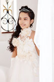 Portrait of pretty little girl in chic white dress Royalty Free Stock Images