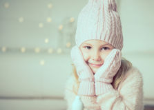 Portrait of pretty little girl in hat and gloves Stock Images