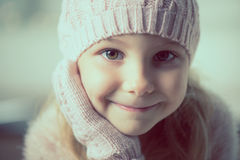Portrait of pretty little girl in hat and gloves Royalty Free Stock Image