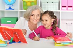 Portrait of pretty little girl and her grandmother stock photography