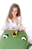 Portrait pretty little girl looking like princess with toy frog isolated Stock Photo