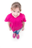 Portrait of pretty little girl looking up. In pink t-shirt. Top view. Isolated on white background Royalty Free Stock Photos