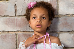 Portrait of a pretty little girl mulatto. Thoughtful lady Royalty Free Stock Photography