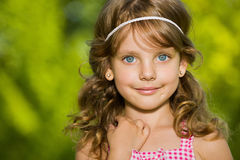 Portrait of a pretty little girl outdoors Royalty Free Stock Photos