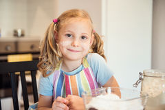 Portrait of pretty little girl preparing Christmas sweets in kit Stock Photography