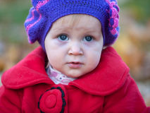 Portrait of a pretty little girl in red coat Royalty Free Stock Photography