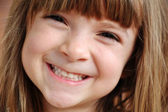 Portrait of a pretty little girl smiling. Portrait of a pretty little girl with bright smile royalty free stock photography