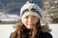 Portrait of a pretty little girl in the snow Royalty Free Stock Image