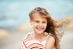 Portrait of a pretty little girl with waving in the wind long ha Stock Photos
