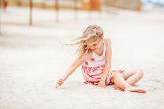 Portrait of a pretty little girl with waving in the wind long ha Stock Photo