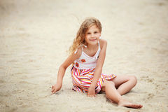 Portrait of a pretty little girl with waving in the wind long ha Royalty Free Stock Photo