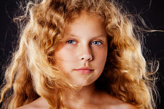 Portrait of pretty little girl with windy hair. Fashion photo Royalty Free Stock Images