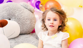 Portrait of pretty little lady with big plush bear Stock Photography