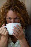 Portrait of pretty mature woman drinking tea Royalty Free Stock Images
