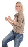 Portrait: Pretty middle aged isolated blond woman cheering over Royalty Free Stock Photo