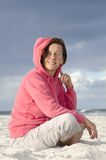 Portrait pretty middle aged woman at beach Stock Images